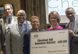 February 3, 2017: Senator Art Haywood presents the Chestnut Hill Business District with a check, made possible through a PA Department of Community and Economic Development grant program, that will go toward the improvement of pedestrian lighting and safety in the commercial corridor.