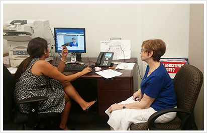 Staffer Rachel Hooper assists a constituent in our Germantown office during SEPTA's Pass Photo ID Day in July.