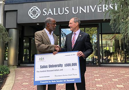 Senator Haywood Presents check to Salus University