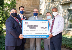 September 15, 2021: Sen. Haywood visited Chestnut Hill Hospital to deliver a check for $500,000 to purchase a new air conditioning unit for the facility.