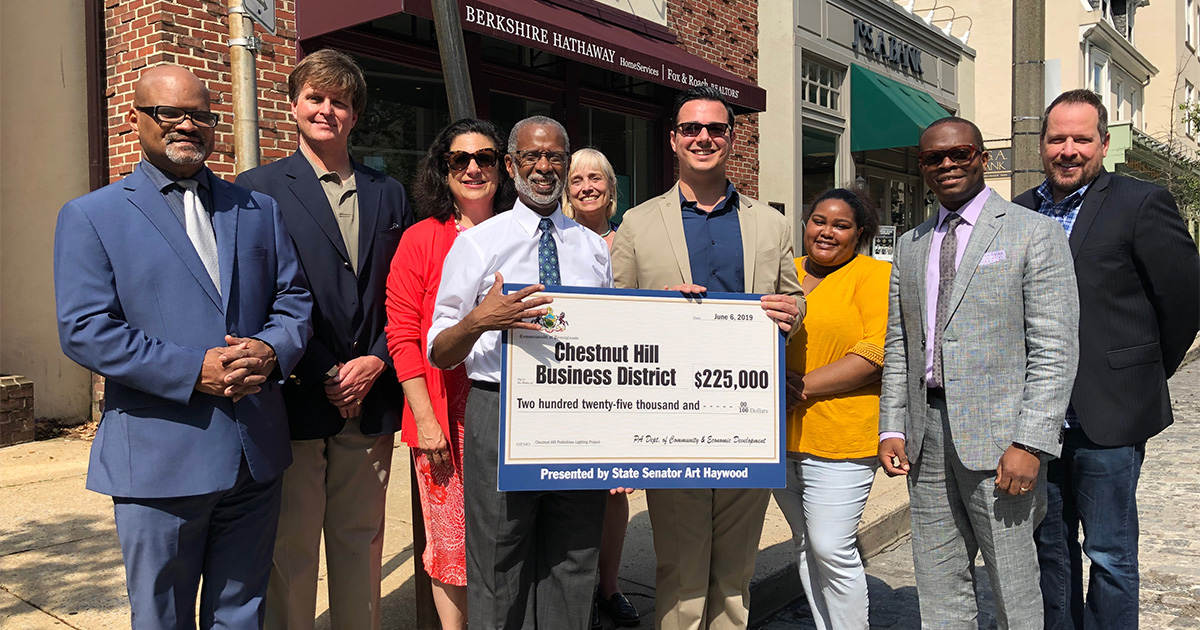 Senator Haywood Presents a Check to the Chestnut Hill Business District